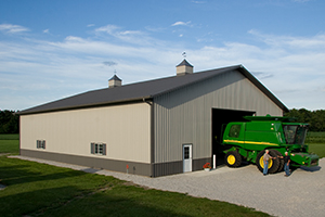 Combine in Front of Barn